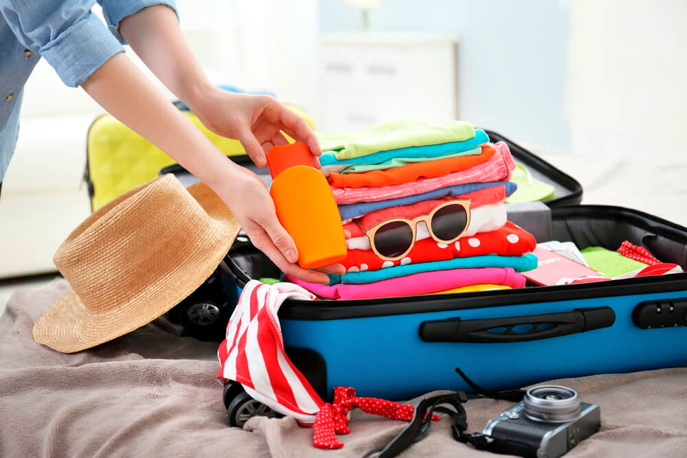 Como preparar as malas para uma viagem de férias na praia